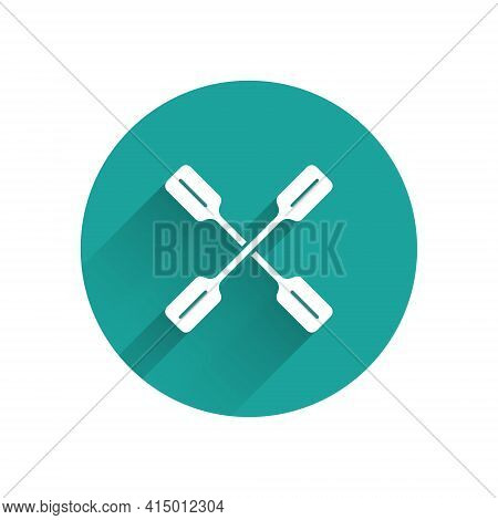 White Paddle Icon Isolated With Long Shadow. Paddle Boat Oars. Green Circle Button. Vector