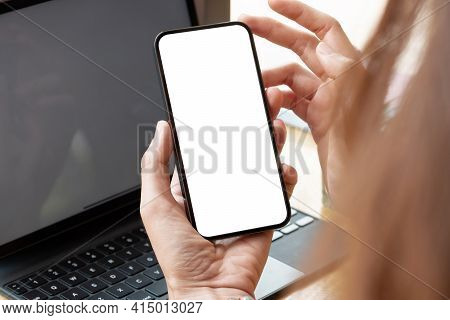 Top View Of Woman Hand Using Smartphone With Blank White Screen