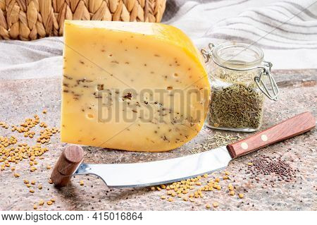 Cheese Collection, Piece Of Hard Yellow Dutch Gouda Cheese With Dried Caraway Or Cumin Seeds