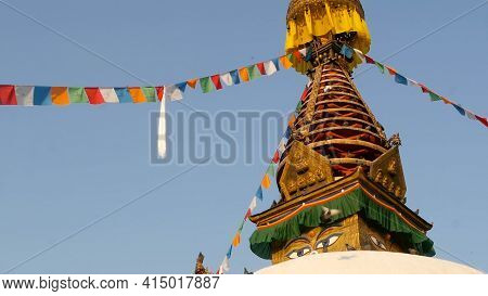 Colorful Prayer Flags Wawing In The Wind Over Stupa Temple, Holy Pagoda, Symbol Of Nepal And Kathman