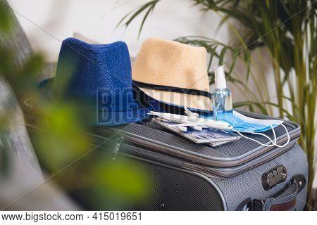 Travelling During Corona Virus Epidemic. Passports And Protective Masks Respirator With Hand Sanitiz