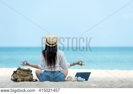 Lifestyle Freelance Woman Relax And Sitting Meditation On The Beach. Asia People Using Laptop Worki