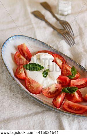 Traditional Italian Salad With Burrata Cheese, Tomatoes And Fresh Basil. Mozzarella Burrata Salad Wi
