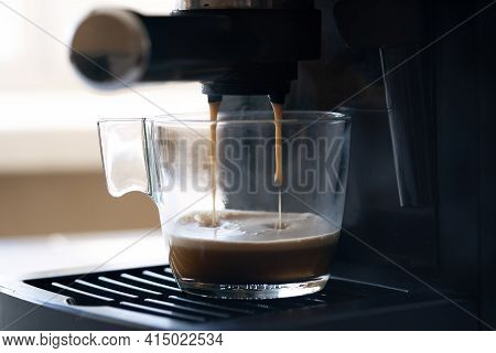 Coffee Machine Making Espresso In Glass Transparent Coffee Cup. Hot Espresso Running Into Cup - Imag