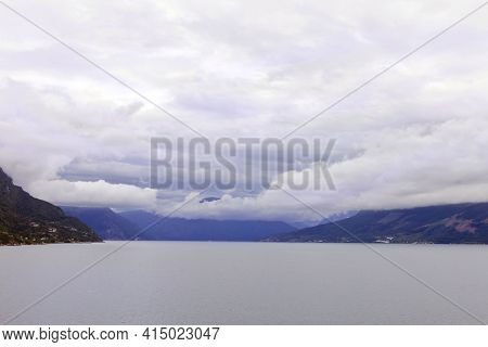 Beautiful View Of The Norwegian Fjord. Summer In Scandinavia, Norway. Cloudy Sky On The Mountains.