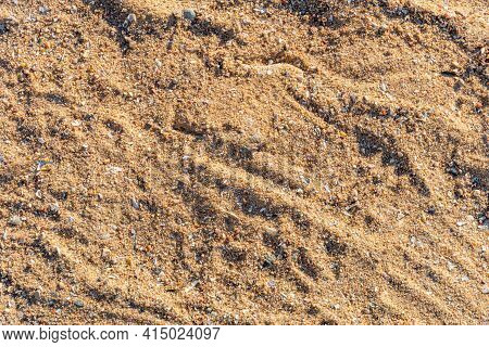 Sand Texture On The Beach At Sunset, Sand Background, Uneven Sand Pattern