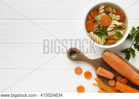Flat Lay Fusilli Broccoli Carrots Bowl With Copy Space. High Quality And Resolution Beautiful Photo