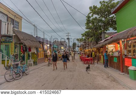 Tourists On A Sandy Road In Holbox Island, Quintana Roo, Mexico