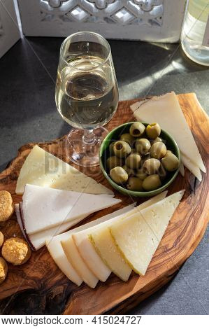 Tasting Of Fortified Andalusian Fino Sherry Wine With Traditional Spanisch Tapas, Green Olives, Goat