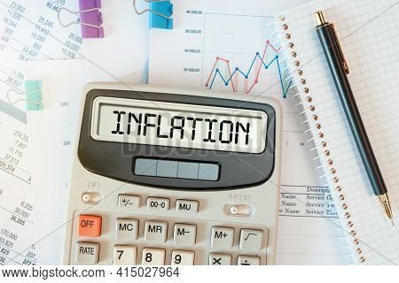 Inflation Word On Calculator. Business And Tax Concept.