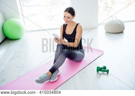 Full Length Profile Side Photo Of Young Attractive Woman Break Pause Sit Mat Look Browse Cellphone S