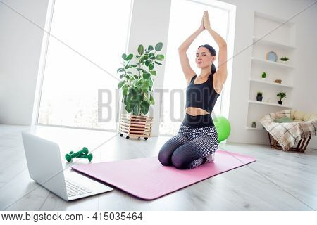 Full Length Portrait Of Calm Concentrated Lady Closed Eyes Hands Palms Above Head Meditate Sit On Pi