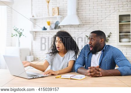 Shocked Multiracial Couple Staring On The Laptop Screen, Saw Unexpected Bad News Or Received Huge Ut