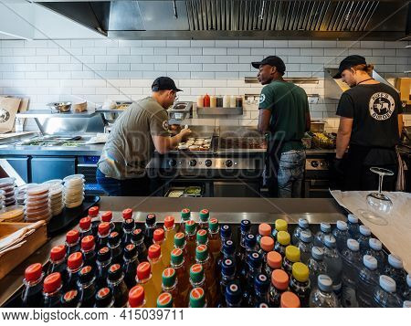 Roppenheim, France- Sept 8, 2018: Rear View Of Multi Ethnic Workers Inside Cafeteria Burger Restaura
