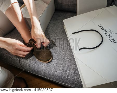 Paris, France - Sep 8, 2018: Close-up Detail Of Woman Hands Tying Laces On New Nubuck Luxury Leather