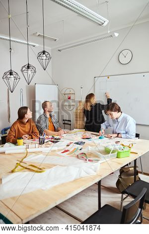 Work In The Dressmaking Establishment With Several Designers Together