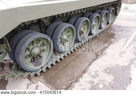 Tank Wheels Close-up. Iron Tracks Of A Heavy Military Tank. Iron Caterpillars And Wheels Of A Milita