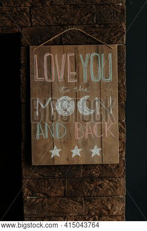 Love Message On A Woooden Board. Love You To The Moon And Back. High Quality Photo