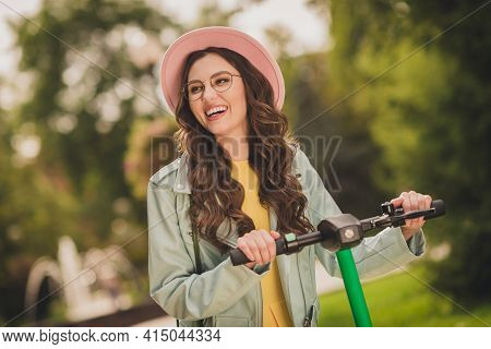 Photo Of Young Happy Smiling Positive Good Mood Lovely Pretty Girl In Glasses And Pink Hat Ride Scoo
