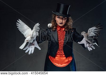 Caucasian Actress Wearing Top Hat And Little White Birds In Studio