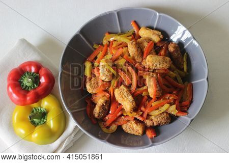 Paneer Nuggets. Breaded And Air Fried Cottage Cheese Served With Sauteed Bell Peppers, Fresh Chopped