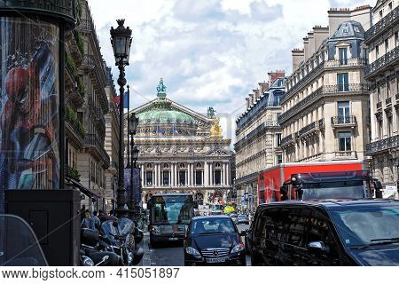 Paris, France, June 22: View Of The Grand Opera Building Through Heavy Traffic On The Avenue Opera O