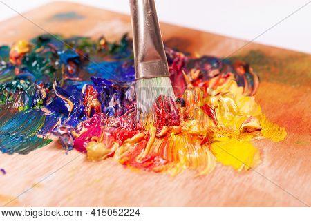 Paint Brush Mixed Different Color Oil Paints. Colorful Acrylic. Modern Art Concept