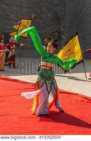 Xian, China - April 30, 2010: Ceremony Show In Front Of North Gate Of Shuncheng City Wall. Female Da