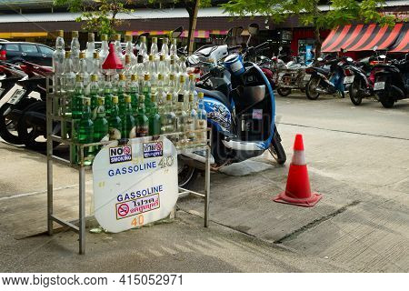 2019-11-05 / Phuket, Thailand - Bottles Of Gasoline For Sale In A Motorcycle Rental Stand.