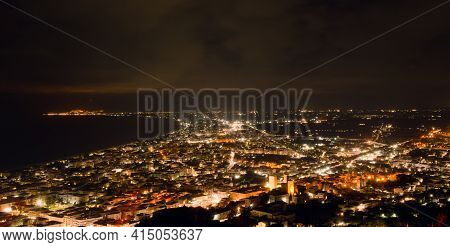 Aerial Night View Of The City Of Terracina, Italy, By The Mediterranean Sea.