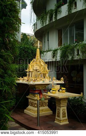 Religious Offerings In A Small Buddhist Shrine In A Street Of Phuket, Thailand.