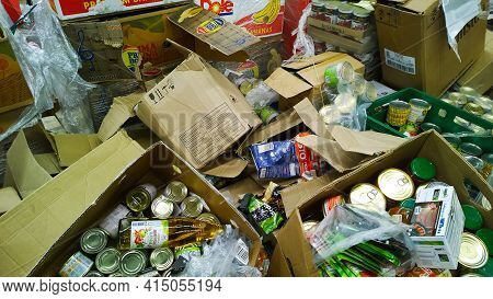St. Petersburg, Russia - December, 2019: Pile Of Dirty Cardboard Boxes With Canned Food. Clutter, Tr