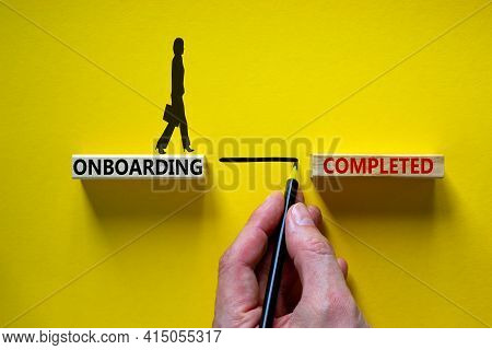 Onboarding Completed Symbol. Wooden Blocks With Words 'onboarding Completed'. Businessman Hand. Busi