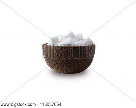 Sugar Cube Isolated On White. Selective Focus. Sugar Cube In Wooden Bowl On White Background. Heap O