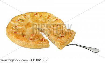 savory pie with a slice raised