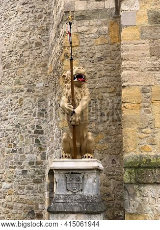 The newly refurbished golden lions are returned to the city Bargate. The lions have stood watch over the city for centuries. Southampton, UK