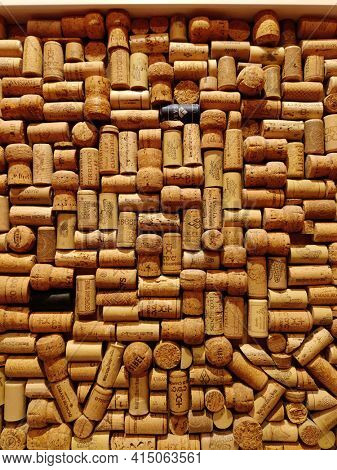 Saint-Petersburg, RUSSIA - March 25, 2021 : Wine corks background. Closeup pattern background of many different wine corks with dates and drops of wine.
