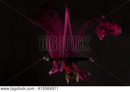 Teen Dancer Performing Acrobatic Dance On Aerial Silks