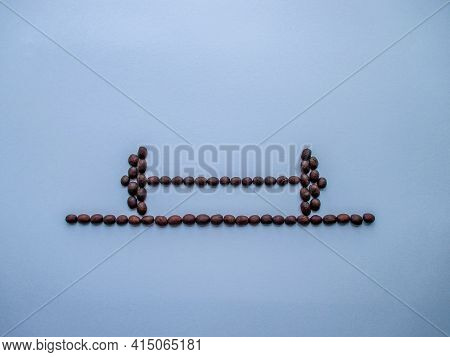 The Barbell Is On The Platform. A Bar Made Of Coffee Beans. A Platform Of Coffee Beans. Blue Backgro