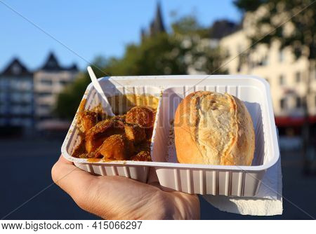German Cuisine - Curry Wurst In Cologne, Germany. Curry Wurst In A German Sausage With Curry Sauce,