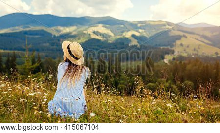 Traveling In Spring Ukraine. Trip To Carpathian Mountains. Young Woman Traveler Relaxing In Flowers
