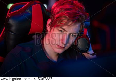 A Cute Gamer Plays An Online Game, Worries About His Teammates, Close-up Portrait