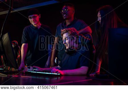 During An Esports Training Session, A Team Of Boys And Girls Sort Out The Latest Game And Smile
