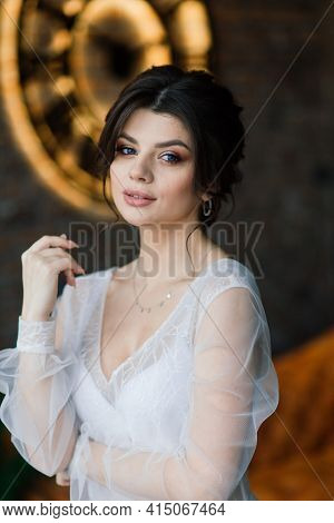 The Bride Is A European-looking Brunette. Single Portrait. Wedding Makeup And Hairstyle. Morning Of