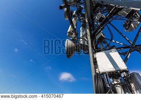 Telecommunication Tower With Microwave Equipment, Radio Panel Antennas, Outdoor Remote Radio Units,