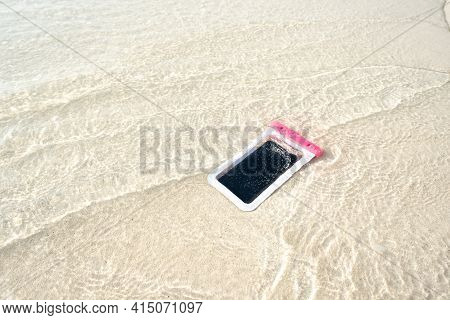 Waterproof Case On A Smartphone, Phone For Taking Pictures Under Water. Phone In The Waterproof Case