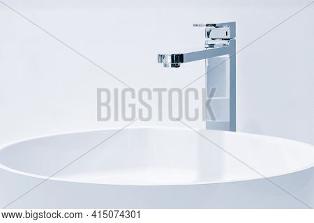 Luxury Faucet Mixer And White Towel On A White Sink In A Beautiful Gray Bathroom. Sanitary Preventio