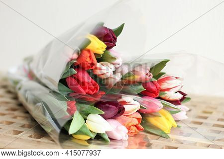 A Bunch Flowers Of Fresh Multicolor Tulips. Beautiful Tulips In A Bud With Water Drops. Selective Fo