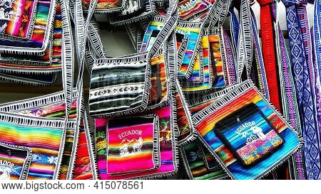 Colorful Bags And Purse Made From Cloth On The Display At The Artisan's Market In Cuenca, Ecuador. T