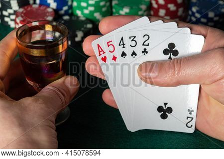 Poker Cards With High Card Or Senior Ace Combination. Close Up Of A Gambler Hand Is Holding Playing